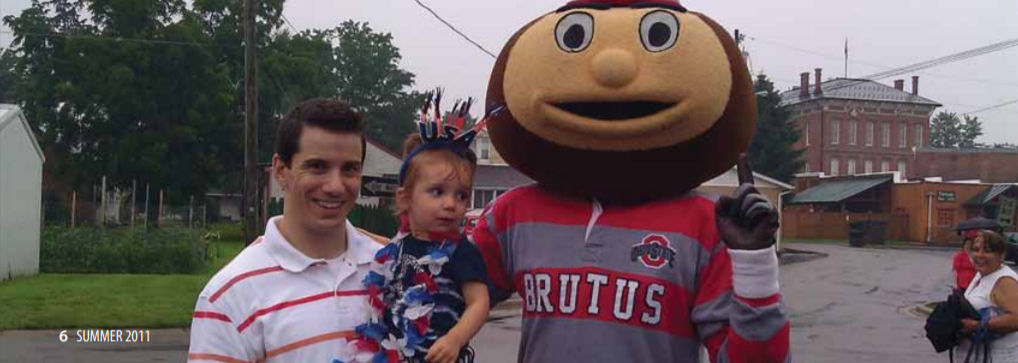 Dr. Myers' granddaughter, Isla (center), joins her father, Scott (left) and Brutus Buckeye (right) for the Independence Day activities in Groveport, Ohio