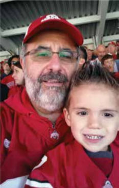 Grandson, Sladen, cheering the Buckeyes on to a win over Indiana at his first Ohio State football game.