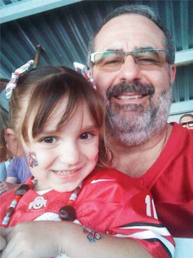 granddaughter, Isla, at her first football game